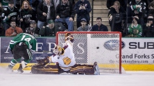 UND's Austin Poganski scores the winning shot against UMD's Kasimir Kaskisuo during a penalty shot in overtime at the Ralph Engelstad Arena in Grand Forks, ND