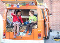 Ruby Castle, left, laughs with Roland Johnson as they sit in the back of a VW bus at Alley Alive in Grand Forks May 4, 2017.