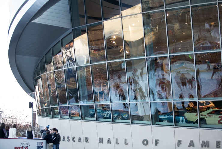 Reflections of ice skaters streatch across the windows at the Nascar Hall of Fame. Holiday on Ice is an annual event held around Christmas.