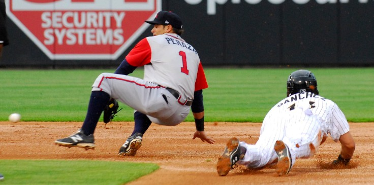 The Gwinnett Brave's Jose Peraza, left tries to recover the throw from home plate after the Charlotte Knight's Carlos Sanchez slides safely into second base at the BB&T BallPark in Charlotte, NC on Friday April 17, 2015.