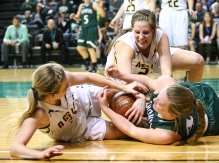Park River's Kaitlyn Brintnell, left, and Taylor Dalbey, center fight for the ball against Thompson's Kailen Dolleslager during the class B region 2 girls basketball championship game in Grand Forks on Thursday, February 23, 2017. (Joshua Komer / Grand Forks Herald)