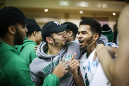 Quinton Hooker is congratulated by UND football junior John Santiago after winning the final home game at the Betty in Grand Forks on Saturday, March 4, 2017. (Joshua Komer / Grand Forks Herald)