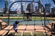 Kit Noblett, 10, hits a ball at an event for Charlotte Knights season-ticket holders at BB&T ballpark