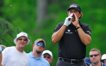 "Phil Mickelson shouts ""fore!"" to spectators to warm them of a drive that went awry on the 9th green during the second round of the Wells Fargo Championship at the Quail Hollow Club in Charlotte, NC on Friday May 15, 2015."