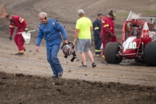 Lawrence Veralrud walks away from his wrecked sprint car at the River Cities Speedway in Grand Forks, ND on Friday, July 3, 2015. (Grand Forks herald/ Joshua Komer)