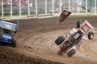 Lawrence Veralrud, right, flips during a crash while Jade Hastings, left, evades the wreckage at the River Cities Speedway in Grand Forks, ND on Friday, July 3, 2015.