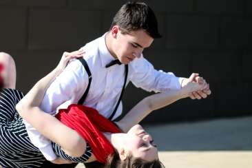 Anthony Screier, top, dips Isabella Eagan while dancing to music to promote the Greater Grand Forks Symphony Orchestra concert at the Empire Arts Center on Sunday. The mimes will appear outside of a variety of businesses today and Saturday, too. (Joshua Komer/Grand Forks Herald)