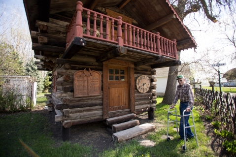 Otto Aaland stands by the cabin he built back in 2007 at his farm in Northwood, ND on Friday, May 6, 2016. (Joshua Komer/Grand Forks Herald)