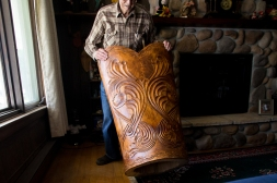 Otto Aaland shows off the back of one of the chairs he carved that is more elaborate in Northwood, ND on Friday, May 6, 2016. (Joshua Komer/Grand Forks Herald)