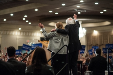 Sen. Bernie Sanders and his wife Jane Sanders wave to the crowd after his speech in Fargo on Friday (Joshua Komer / Grand Forks Herald)