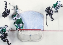 University of North Dakota's Cam Johnson, center, lays out to stop the puck against Omaha's Ryan Galt, top left, at the Ralph Engelstad Arena in Grand Forks on Saturday, February 26, 2017. (Joshua Komer / Grand Forks Herald)
